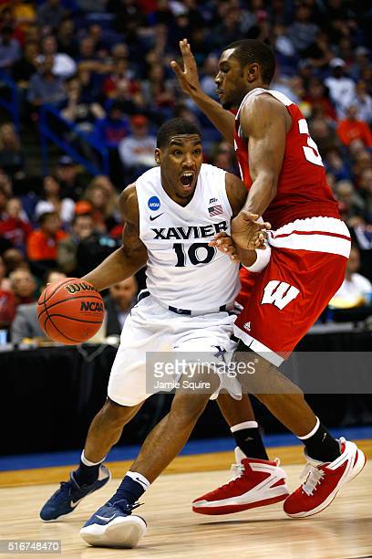 Remy Abell of the Xavier Musketeers handles the ball against Vitto Brown of the Wisconsin Badgers in the second half during the second round of the...