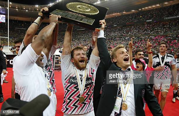 Remy Bonfils and Jules Plisson of Stade Francais celebrate winning the Bouclier de Brennus Trophy after the Top 14 Final between ASM Clermont...