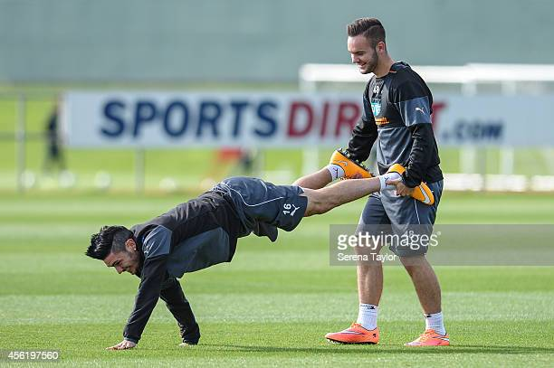 Remy Cabella and Adam Armstrong perform a wheelbarrow during the warm up at the training session at The Newcastle United Training Centre on September...