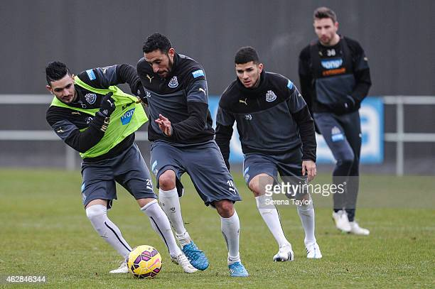 Remy Cabella and Jonas Guiterrez tussle for the ball whilst Mehdi Abeid and Paul Dummet are seen in the background during a training session at The...