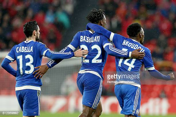 Remy Cabella Michy Batshuayi and Georges Kevin Nkoudou of Marseille celebrate after scoring during the UEFA Europa League Football round of 32 second...