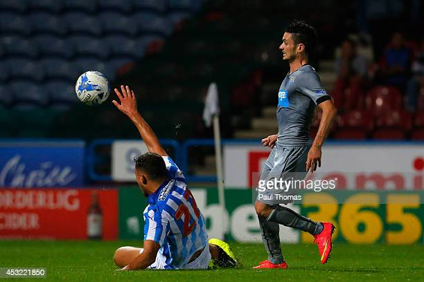 Remy Cabella of Newcastle scores his sides second goal during the Pre Season Friendly match between Huddersfield Town and Newcastle United at the...
