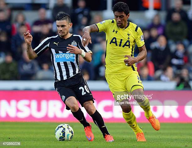 Remy Cabella of Newcastle United and Paulinho of Spurs battle for the ball during the Barclays Premier League match between Newcastle United and...
