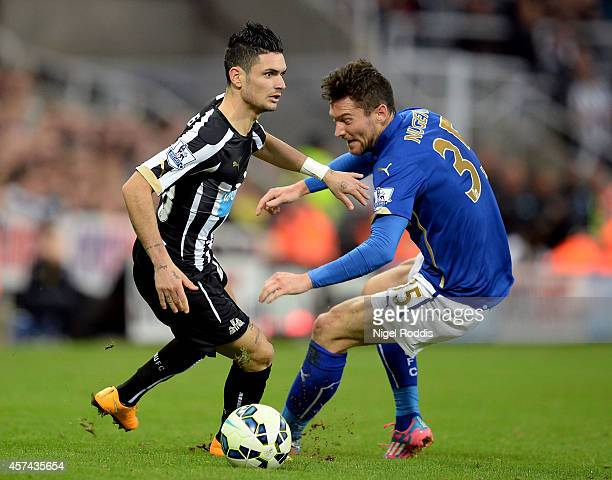 Remy Cabella of Newcastle United goes past David Nugent of Leicester City during the Barclays Premier League match between Newcastle United and...
