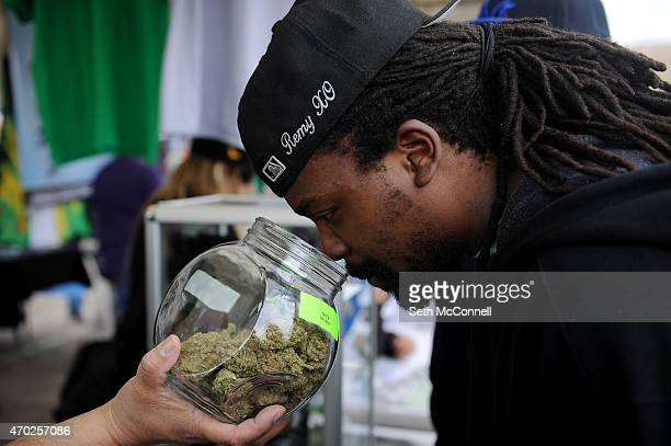 Remy Don of Wichita Kansas smells a strain in a jar at the Moscaseeds booth during the High Times Cannabis Cup at the Denver Mart in Denver Colorado...