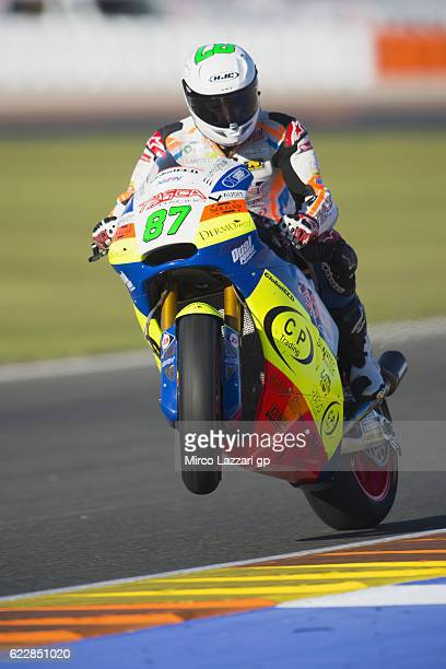 Remy Gardner of Australia and Team Tasca Scuderia Moto2 lifts the front wheel and greets during the MotoGP of Valencia Qualifying at Ricardo Tormo...