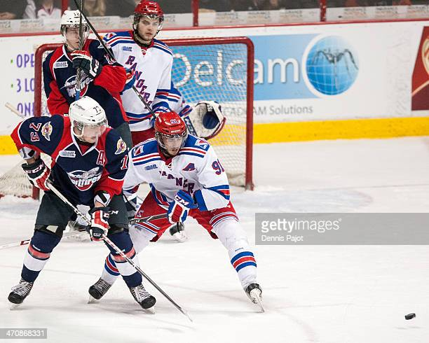 Remy Giftopoulos of the Windsor Spitfires battles out front against Matia Marcantuoni of the Kitchener Rangers on February 20 2014 at the WFCU Centre...