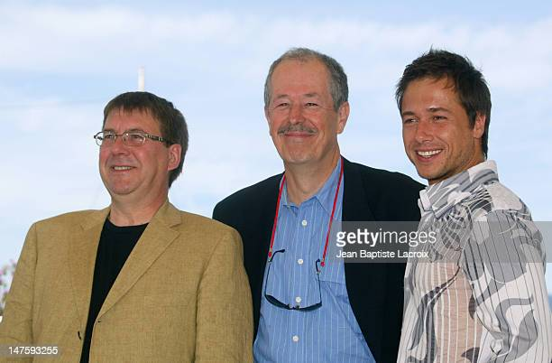 Remy GIRARD Denys ARCAND Stephane ROUSSEAU during 2003 Cannes Film Festival Les Invasions Barbares Photocall at Palais des Festivals in Cannes France