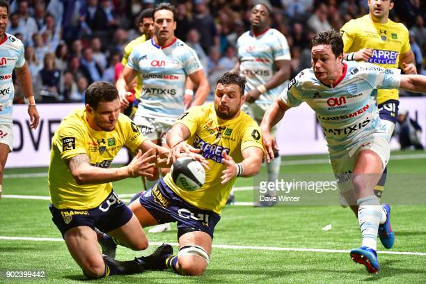 Remy Grosso and Damien Chouly of Clermont try to ground a loose ball as Henry Chavancy of Racing 92 moves in during the Top 14 match between Racing...