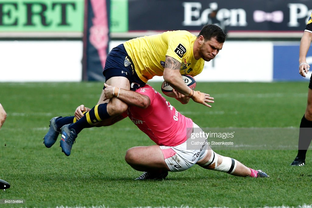 Remy Grosso #11 of ASM Clermont Auvergne is tackled by Remi Bonfils #2 of Stade Francais Paris during the French Top 14 match between Stade Francais Paris and ASM Clermont Auvergne at Stade Jean Bouin on April 7, 2018 in Paris, France.