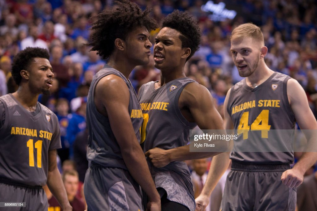Remy Martin #1 and Tra Holder #0 of the Arizona State Sun Devils celebrate after Remy Martin was fouled by a Kansas Jayhawk in the second half at Allen Fieldhouse on December 10, 2017 in Lawrence, Kansas.