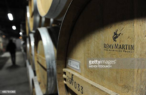 Remy Martin cognac barrels are seen in a wine cellar in Cognac western France on April 10 2014 AFP PHOTO / MEHDI FEDOUACH