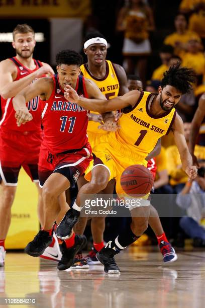 Remy Martin of the Arizona State Sun Devils and Ira Lee of the Arizona Wildcats fight for a loose ball during the first half of the college...