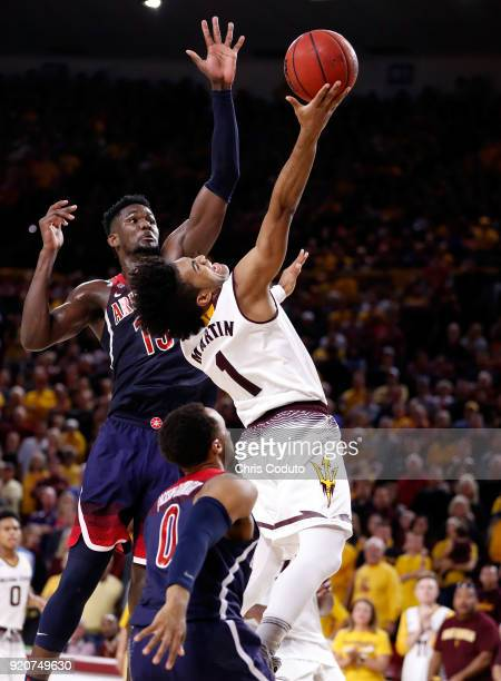Remy Martin of the Arizona State Sun Devils shoots over Deandre Ayton of the Arizona Wildcats during the second half of the college basketball game...