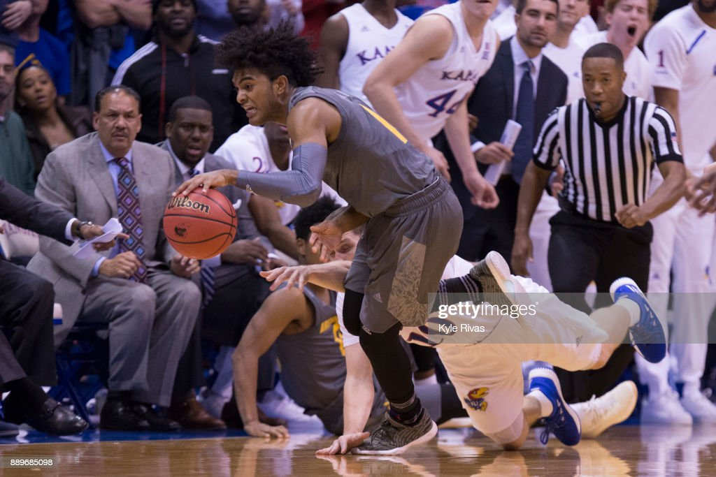 Remy Martin #1 of the Arizona State Sun Devils steals the ball away from Sviatoslav Mykhailiuk #10 of the Kansas Jayhawks in the second half at Allen Fieldhouse on December 10, 2017 in Lawrence, Kansas.