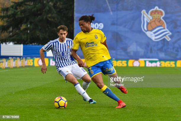 Remy of U D Las Palmas duels for the ball with Adnan Januzaj of Real Sociedad during the Spanish league football match between Real Sociedad and U D...