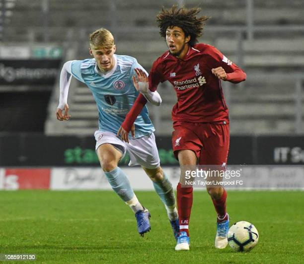 Remy Savage of Liverpool and Harry Perritt of Accrington Stanley in action during the FA Youth Cup tie at Langtree Park on January 21 2019 in St...