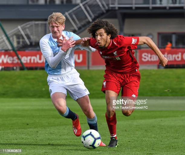 Remy Savage of Liverpool and Luke Brennan of Blackburn Rovers in action during the U18 Premier League game at The Kirkby Academy on March 2 2019 in...