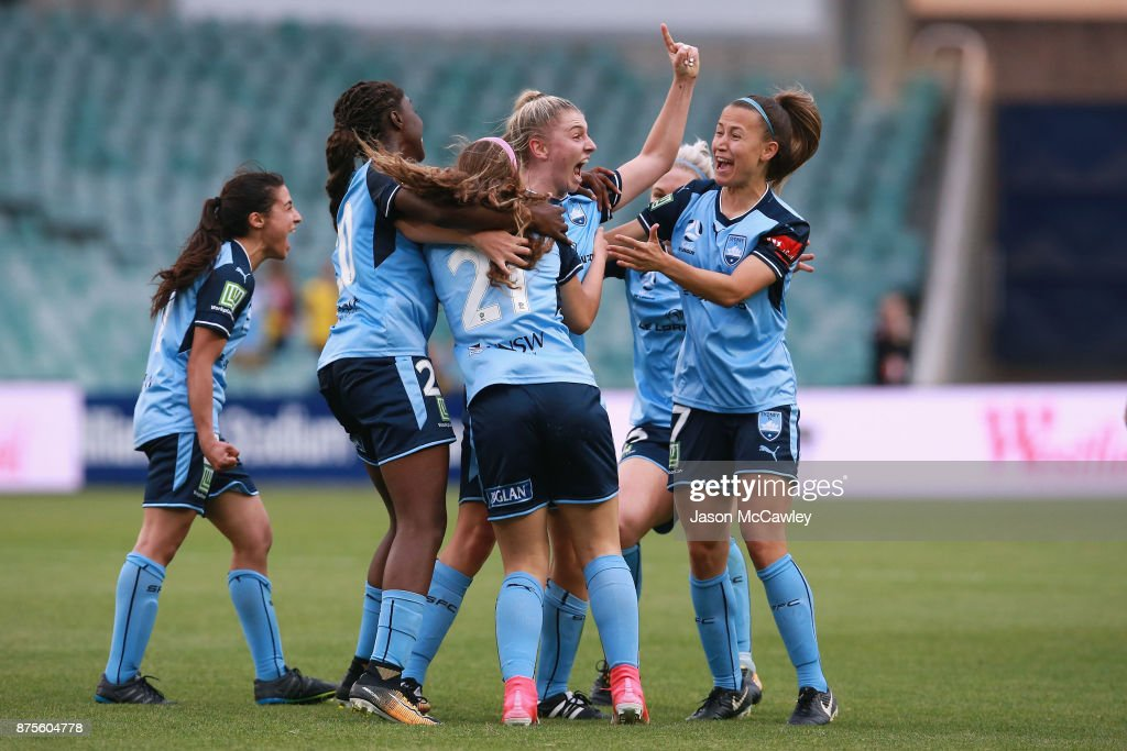 Remy Siemsen of Sydney celebrates with team mates after scoring a goal during the round four W-League match between Sydney and Melbourne City at Allianz Stadium on November 18, 2017 in Sydney, Australia.
