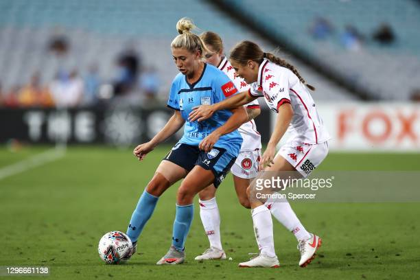 Remy Siemsen of Sydney FC is tackled during the round four W-League match between Sydney FC and the Western Sydney Wanderers at ANZ Stadium, on...