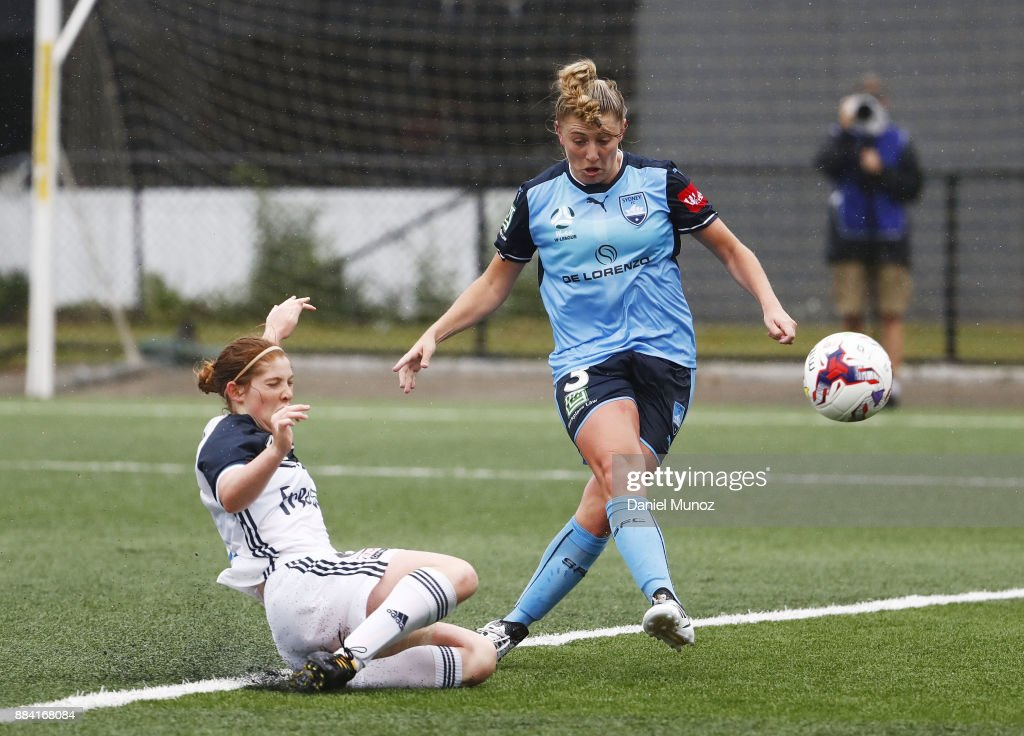 Remy Siemsen of Sydney FC shoots under the pressure of Annabel Martin of Melbourne during the round six W-League match between Sydney FC and Melbourne Victory at Cromer Park on December 2, 2017 in Sydney, Australia.