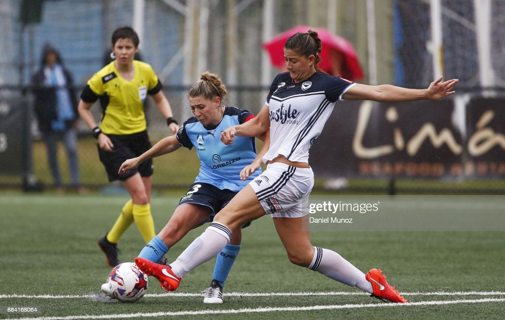 Remy Siemsen of Sydney FC shoots under the pressure of Laura Alleway of Melbourne during the round six W-League match between Sydney FC and Melbourne Victory at Cromer Park on December 2, 2017 in Sydney, Australia.