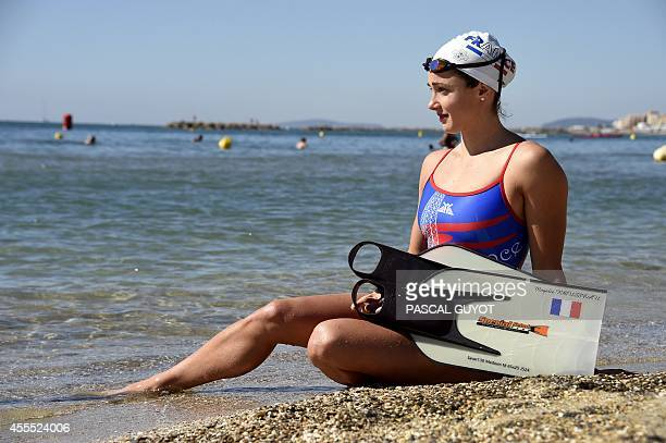 Remy ZAKA French swimmer Magali Rousseau poses on September 13 2014 at PalavaslesFlots southern France ahead of the Surf Live Saving World...