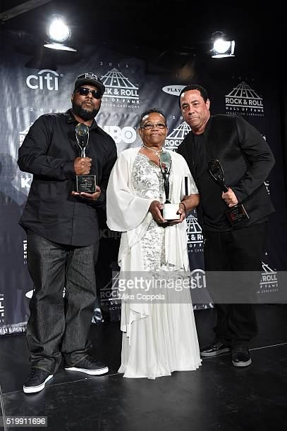 Ren and DJ Yella of NWA pose with EazyE's mother Katie Wright at the 31st Annual Rock And Roll Hall Of Fame Induction Ceremony at Barclays Center on...