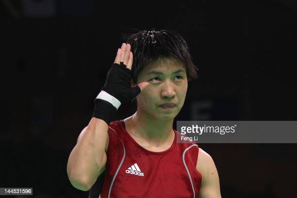 Ren Cancan of China celebrates winning against Azize Nimani of Germany in the Women's 51kg preliminary match during the AIBA Women's World Boxing...