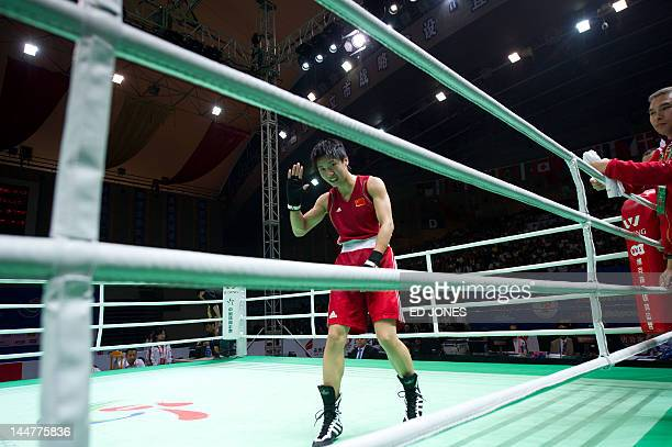 Ren Cancan of China waves following her win against Nicola Adams of England during their flyweight 51kg final bout at the Women's World Boxing...