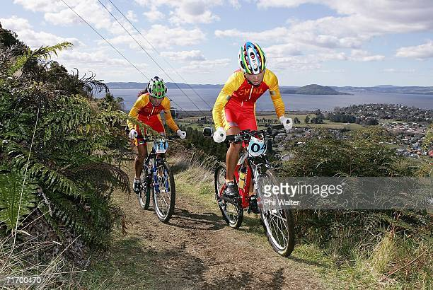 Ren Chengyuan and Ying Liu of China climb up the slopes of Mount Ngongotaha with Lake Rotorua in the background during the U23 Women's Cross Country...