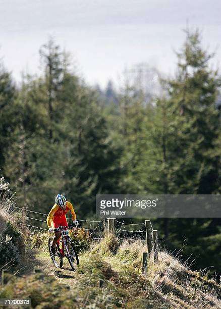 Ren Chengyuan of China climbs up the slopes of Mount Ngongotaha with Lake Rotorua in the background during the U23 Women's Cross Country competition...