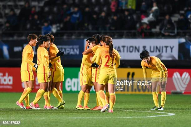 Ren Guixin of China celebrates a point with teammates during the EAFF E1 Women's Football Championship between South Korea and China at Fukuda Denshi...