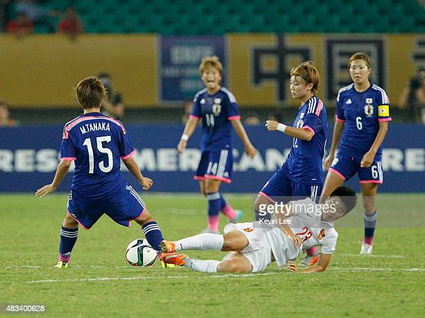 Ren Guixin of China PR chellenges for the ball against Mina Tanaka of Japan during the EAFF East Asian Cup 2015 final round at the Wuhan Sports...