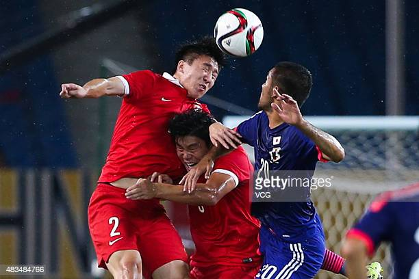 Ren Hang of China competes for the ball against Kengo Kawamata of Japan during men's EAFF East Asian Cup 2015 match between China and Japan at the...