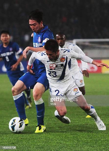 Ren Hang of Jiangsu Sainty and Naoya Tamura of Vegalta Sendai battle for the ball during the AFC Champions League match between Jiangsu Sainty and...