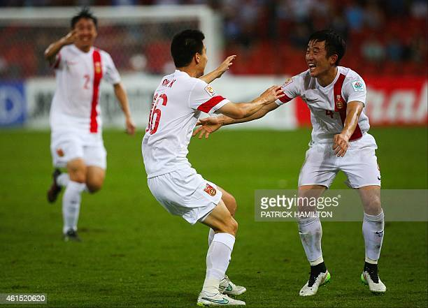 Ren Hang Sun Ke and Jiang Zhipeng of China celebrate a goal during the first round Asian Cup soccer match between China and Uzbekistan at the Suncorp...