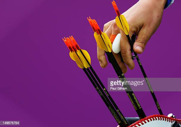 Ren Hayakawa of Japan competes in her Women's Individual Archery 1/16 Eliminations match against Inna Stepanova of Russia during Day 4 of the London...