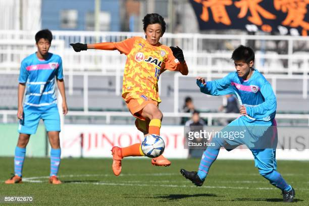 Ren Higashi of Shimizu SPulse and Yuei Iwasaki of Sagan Tosu compete for the ball during the Prince Takamado Cup 29th All Japan Youth Football...