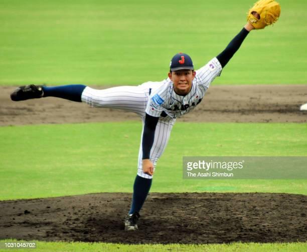 Ren Kakigi of Japan throws during the BFA U18 Asian Championship third place match between Japan and China at Sun Marine Stadium Miyazaki on...