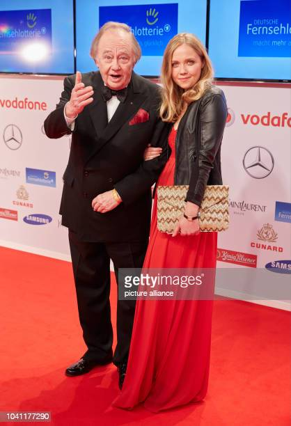 René Kollo and his daughter Florence arrive at the 50th Golden Camera Award show in Hamburg Germany 27 February 2015 Photo Georg Wendt/dpa | usage...