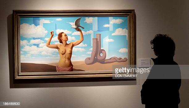 René Magritte's 'Le domaine enchanté ' is displayed October 31 2013 at Christie's in New York The oil on canvas is part of the Impressionist and...