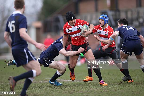 Ren Takano of Japan runs with the ball during the International Rugby Union Challenge Match between Scotland U19 and Japan Schools at Inverleith on...
