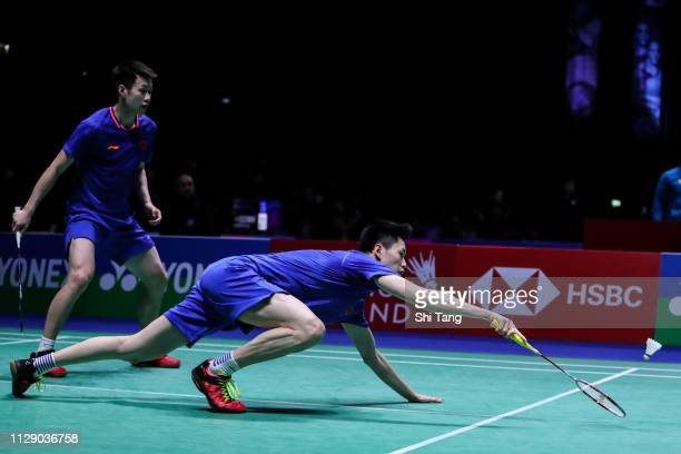 Ren Xiangyu and Ou Xuanyi of China compete in the Men's Doubles second round match against Fajar Alfian and Muhammad Rian Ardianto of Indonesia...