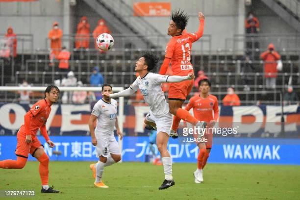 Ren YAMAMOTO of Tochigi SC and Daisuke WATABE of Omiya Ardija battle for the ball during the J.League Meiji Yasuda J2 match between Omiya Ardija and...