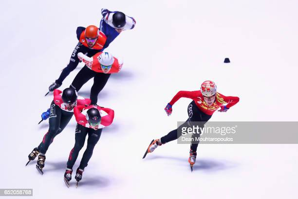 Ren Ziwei of China and Sjinkie Knegt of the Netherlands compete in the 1500m Mens Semi Final at ISU World Short track Speed Skating Championships...