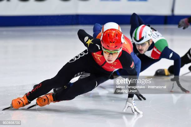 Ren Ziwei of China competes in the men's 1500 meter heats during the World Short Track Speed Skating Championships at Maurice Richard Arena on March...