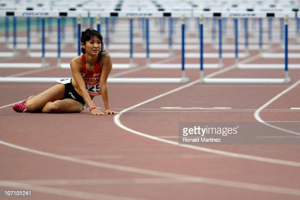Rena Joshita of Japan falls over in the Women's 100m Hurdles Round 1 Heat 1 at Aoti Main Stadium during day twelve of the 16th Asian Games Guangzhou...
