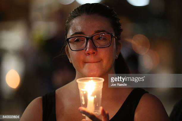 Renae Feldt holds a candle during a memorial service at the Dr Phillips Center for the Performing Arts for the victims of the Pulse gay nightclub...