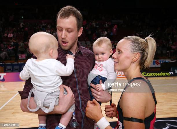 Renae Ingles of the Thunderbirds celebrates her last game with husband Joe and twins Jacob and Milla during the round 14 Super Netball match between...